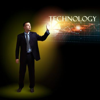 Businessman standing with modern technology symbols next to him