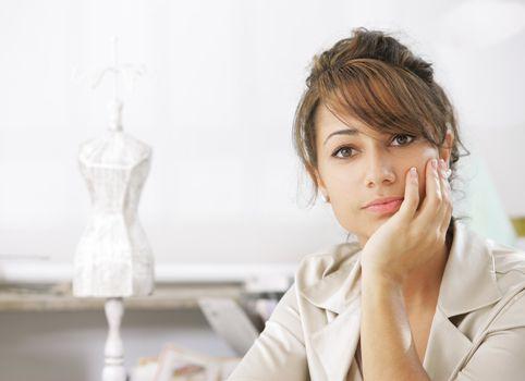 Portrait of attractive female fashion designer