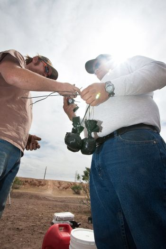 Movie Crew Tying Bags of Explosive Powder