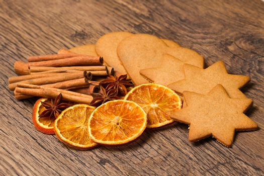 biscuits with  cinnamon and  orange dried on wooden table