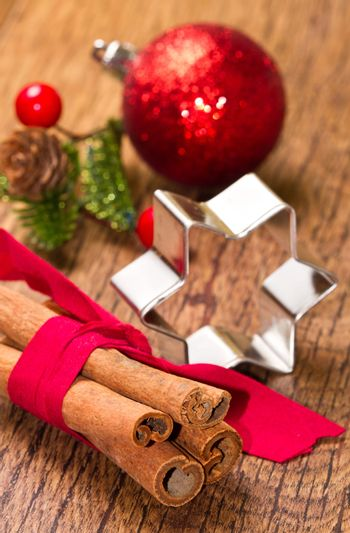 cinnamon sticks with decoration on wooden background