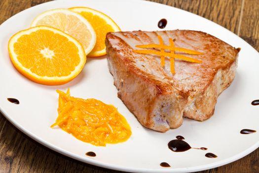 fried tuna fillet with fresh orange and orange sauce
