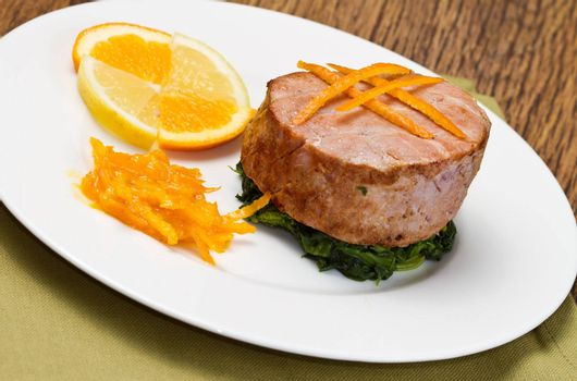 fried tuna fillet with fresh orange ,orange sauce and spinach