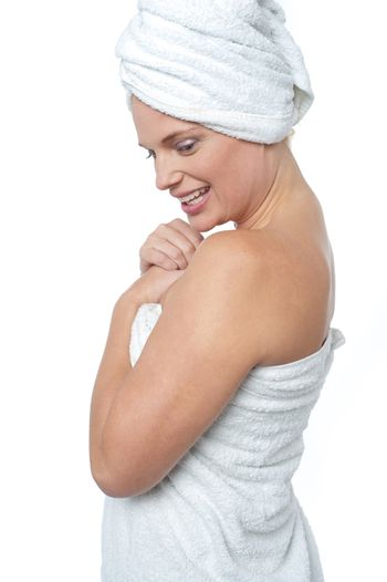 Female wrapping herself in towel after hot spa