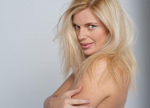 Seductive blonde posing topless
