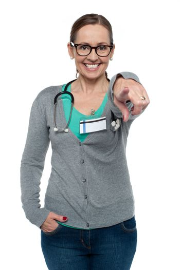 Cheerful medical practitioner pointing at the camera