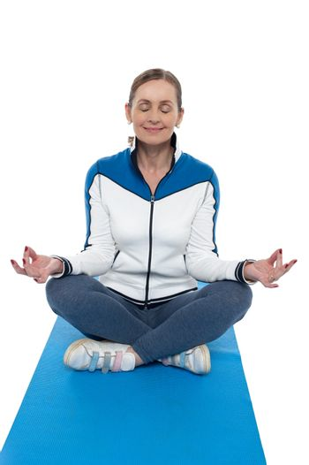 Portrait of a woman sitting in a lotus position