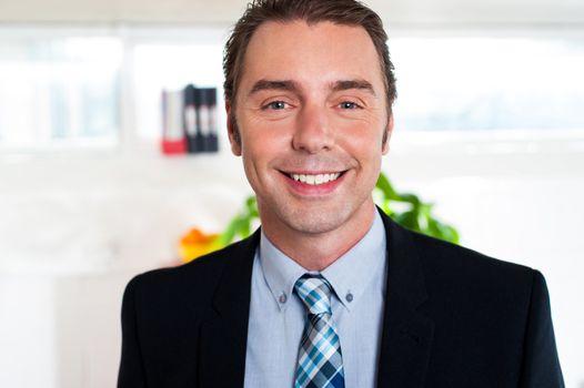 Handsome cheerful businessman