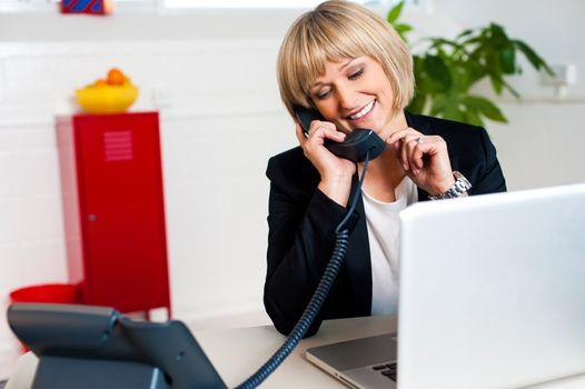 Secretary attending call before passing it to boss