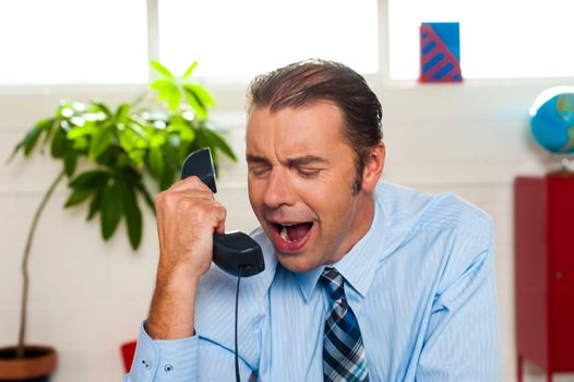 Businessman yelling during the phone call
