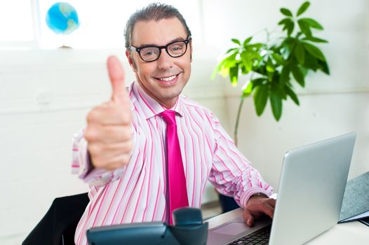 Successful entrepreneur showing thumbs up