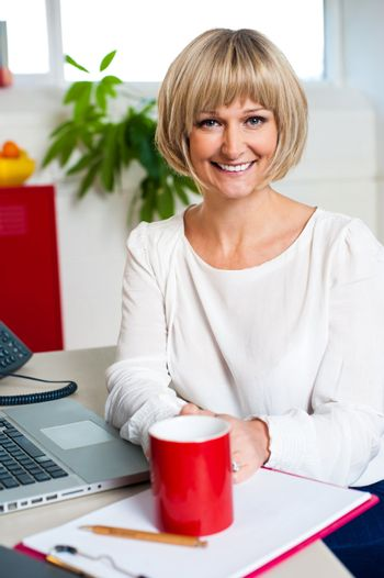 Casual blonde businesswoman in office