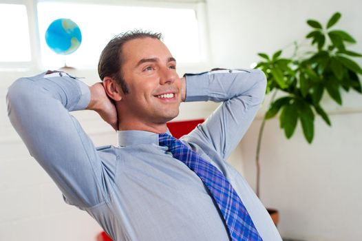 Young businessman relaxing and day dreaming