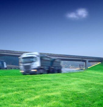 Big semi truck transport on highway