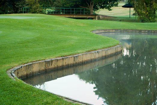 Golf green and water hazard