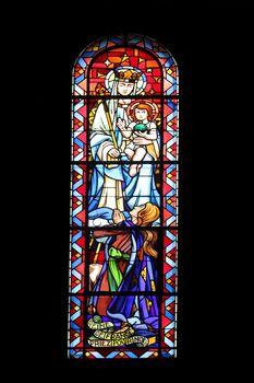 Madonna with child, stained glass, Notre Dame de Clignancourt church, Paris, France