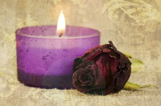 rose and candle on textured background