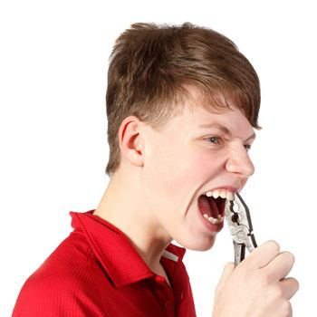 boy pulled himself  teeth with pliers against white background