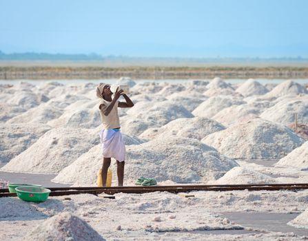 Sambhar, India - Nov 19: Worker drinks water in salt farm on Nov 19, 2012 in Sambhar Salt Lake, India. It is India's largest saline lake and where salt has been farmed for a thousand years.