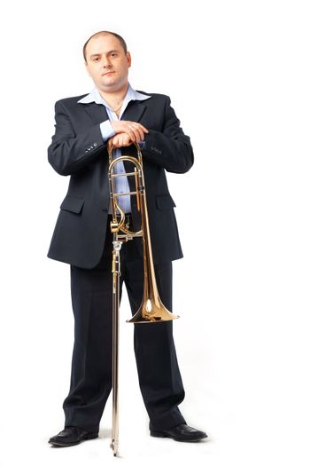 Young man with his trombone.