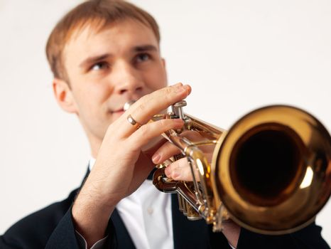 Closeup of the hands of an European musician playing the trumpet