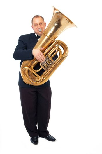 Young tubaist is playing his instrument