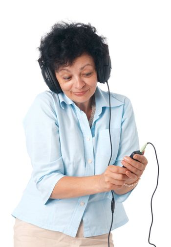 Elder happy woman with phones and mobile listening something.