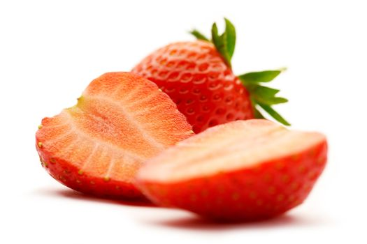 strawberries is sliced in half on white background