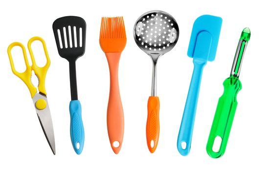 Kitchen tools. Scissors, blade, brush, skimmer, potato peeler. Isolated on white.