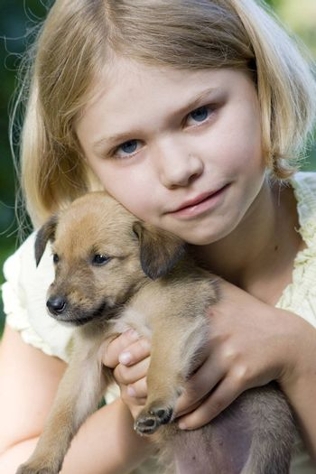 little girl and her young dog