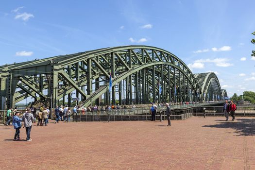 COLOGNE, GERMANY - MAY 11. people enjoy to walk along the promenade at the Hohenzollern bridge on May 11,2011 in Cologne, Germany. It is the most heavily used railway bridge in Germany.