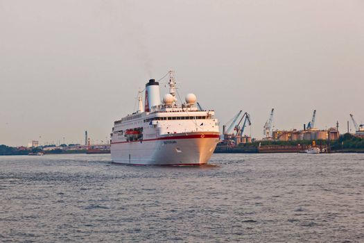 HAMBURG, GERMANY - 25 AUGUST: the famous cruise liner Deutschland with the film crew of the TV series Loveboat leaves the harbor at August 25, 2011 in Hamburg, Germany.