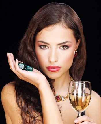 woman holding gamble dices and wine