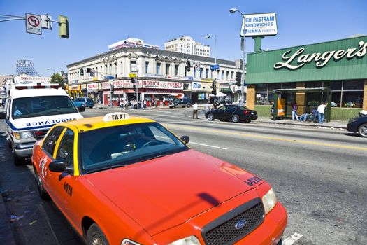 LOS ANGELES, USA - JULY 06: Midday view to the crossing at Langers Square with  old historic buildings on July 6, 2008 in Los Angeles, USA. One of the few reminders of the area's Jewish history is Langer's Deli