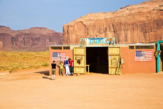 MONUMENT VALLEY, AMERICA - JULY 12:  family is posing  with a picture of John Wayne at John Fords place in monument valley on July 12,2008.