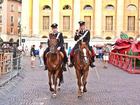 VERONA, ITALY - AUGUST 05: Police on horses are using the mobile and watching and helping the spectators entering the Arena on August 05,2009, Verona, Italy.