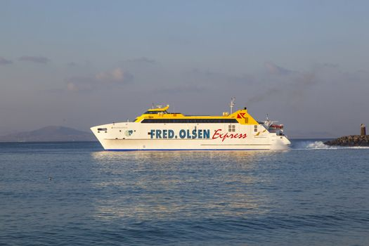 PLAYA BLANCA, SPAIN - APRIL 2: the ferry Bocayna Express from Fred Olsen on the ocean an April 02.2012 in Playa Blanca, Spain. Fred Olsen connects Lanzarote with Fuerteventura since 1962 with his line.