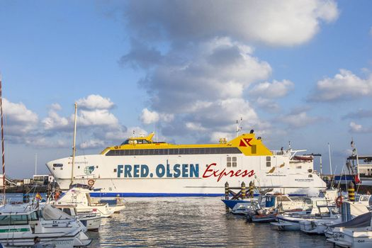 PLAYA BLANCA, SPAIN - APRIL 2: the ferry Bocayna Express from Fred Olsen in the harbor at  April 2,2012 in Playa Blanca, Spain. Fred Olsen connects Lanzarote with Fuerteventura since 1962 with his line.