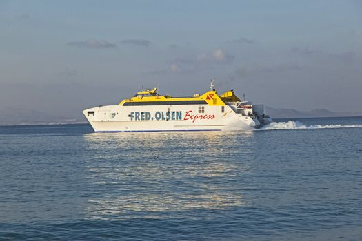 PLAYA BLANCA, SPAIN - APRIL 2: the ferry Bocayna Express from Fred Olsen on the ocean at April 2,2012 in Playa Blanca, Spain. Fred Olsen connects Lanzarote with Fuerteventura since 1962 with his line.