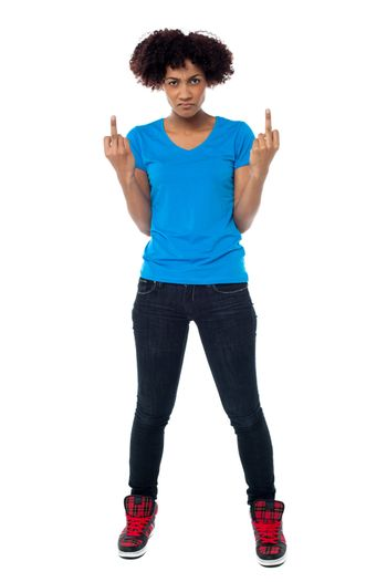 Annoyed young female showing middle finger
