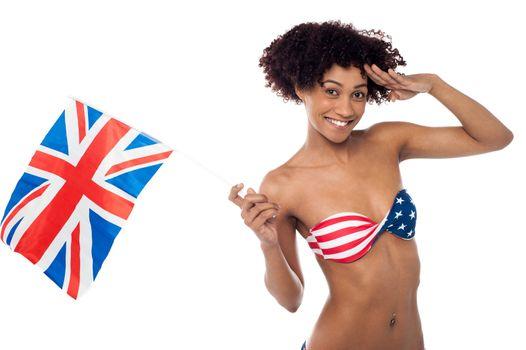 Hot American bikini model saluting and waving UK flag