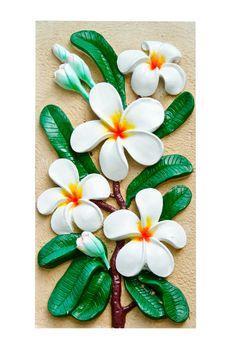 Stucco images of frangipani flowers.