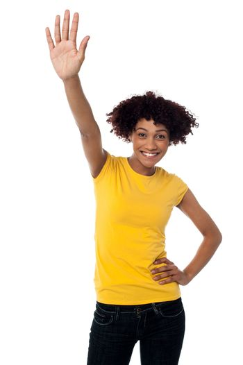Stylish female waving her hand at you