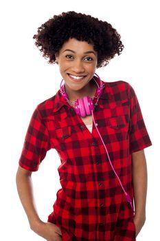 Stylish teenager with headphones around her neck