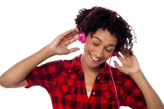 Casual woman lost in pleasant musical world