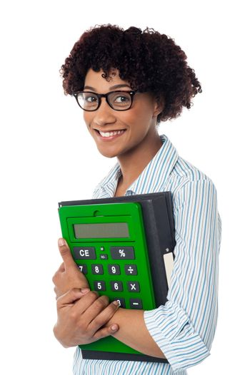 Young businesswoman with calculator and file