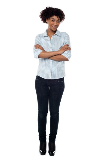Confident young female with folded arms