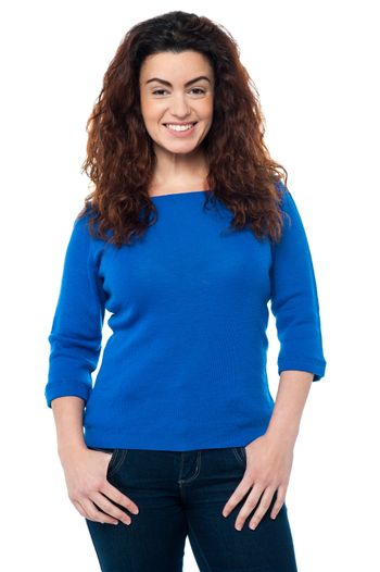 Pretty woman with long curly hair in casuals