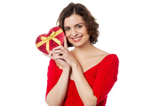 Woman closely holding gift from her boyfriend
