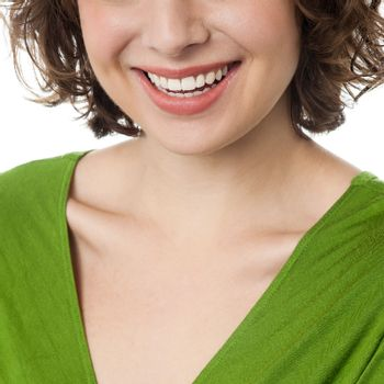 Cropped image of a woman flashing wide smile